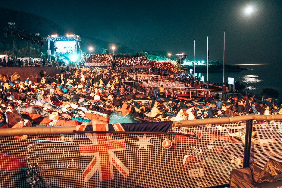 Visitors to Gallipoli sit through the night waiting for dawn