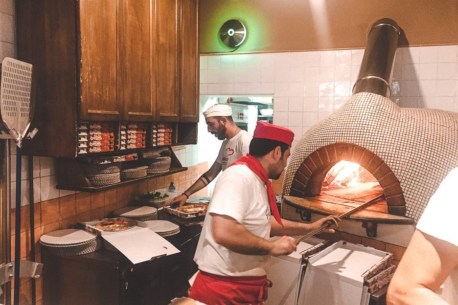 Chefs hard at work at Gusto Pizza, Florence