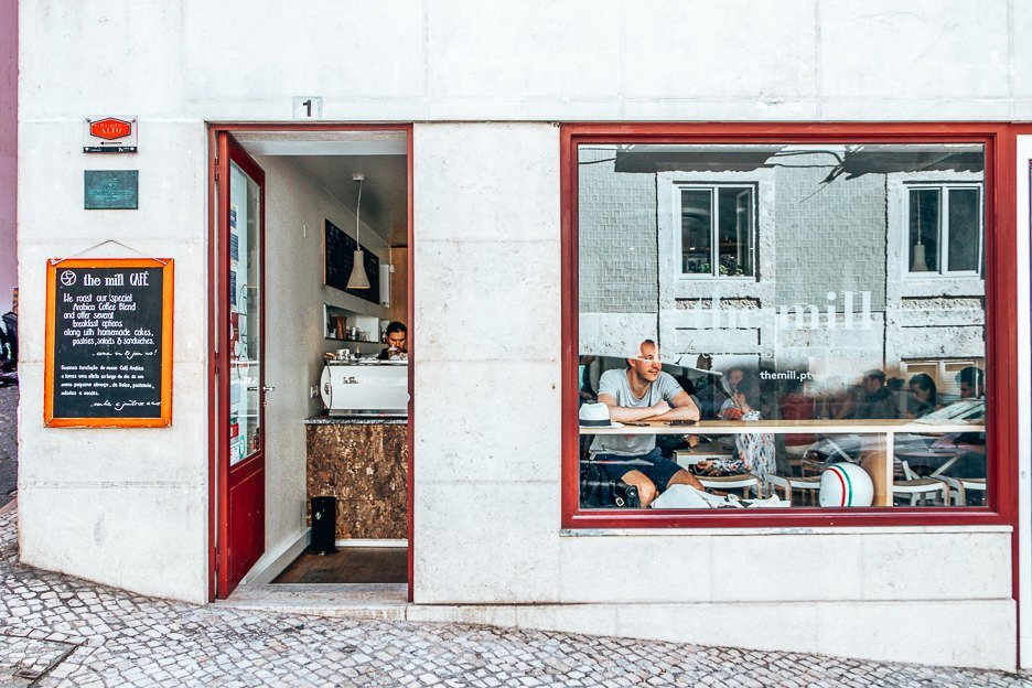 Sitting in the window of The Mill, Lisbon Portugal