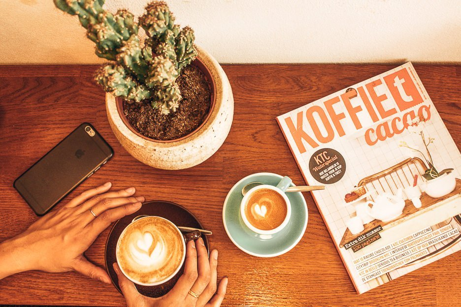 Coffees, magazine and cactus at Sweet Cup Roastery