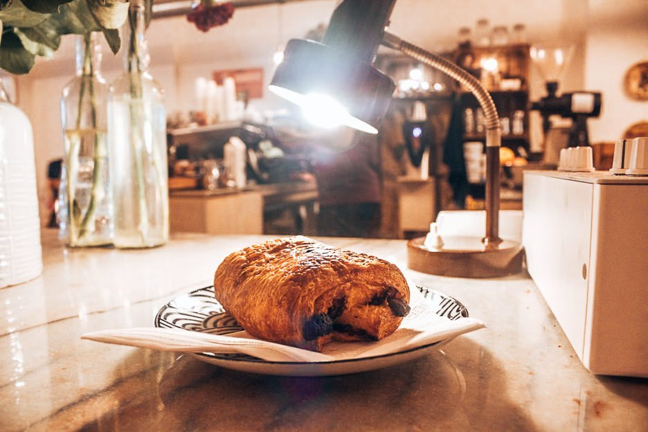 Chocolate croissant under lamplight at White Label Coffee
