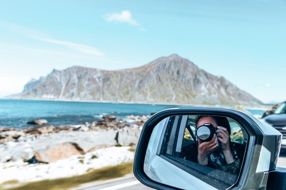 Jasmine taking a photo from the campervan in Lofoten, Norway