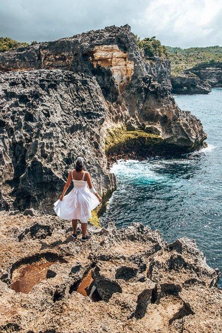 Jasmine standing above Angel's Billabong, Nusa Penida