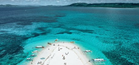 An aerial view of visitors visiting Naked Island, Siargao, The Philippines