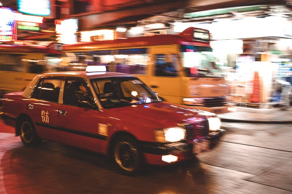The blur of a red taxi driving by at night in Mong Kok, Hong Kong - shot with Canon EF 50mm lens