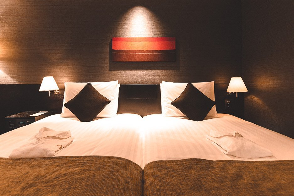 The beds in the Essential Hollywood Twin Room - The Gate Hotel Kaminarimon by HULIC, Tokyo