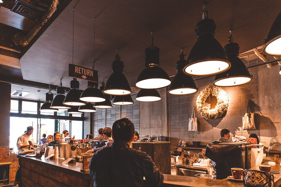 Centre coffee counter and bench seating at The Roastery by Nozy Coffee | best coffee harajuku