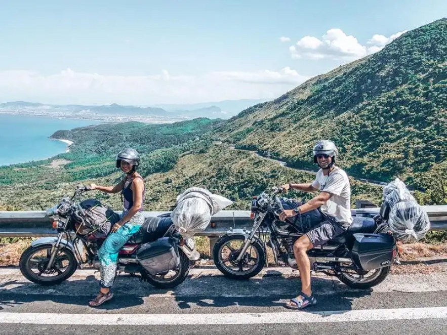 Picture of two people on motorbikes on the Hai Van Pass between Hue to Hoi An Vietnam