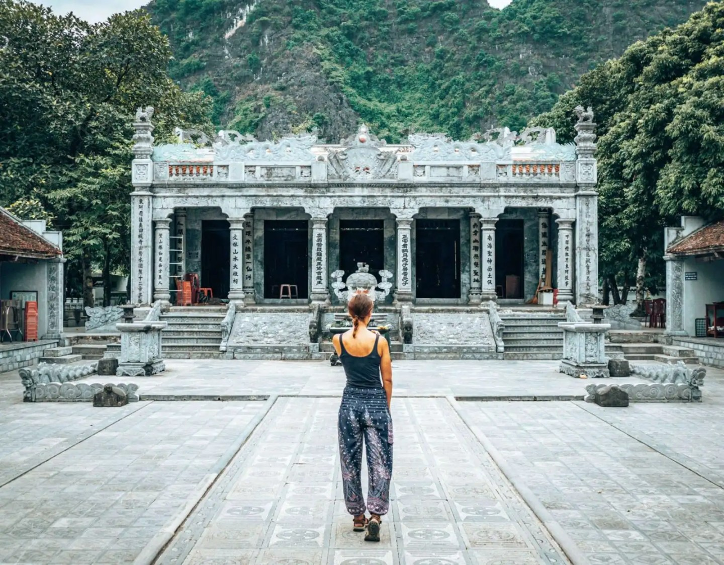 Girl in front of the Thai Vi Temple in Tam Coc, Vietnam