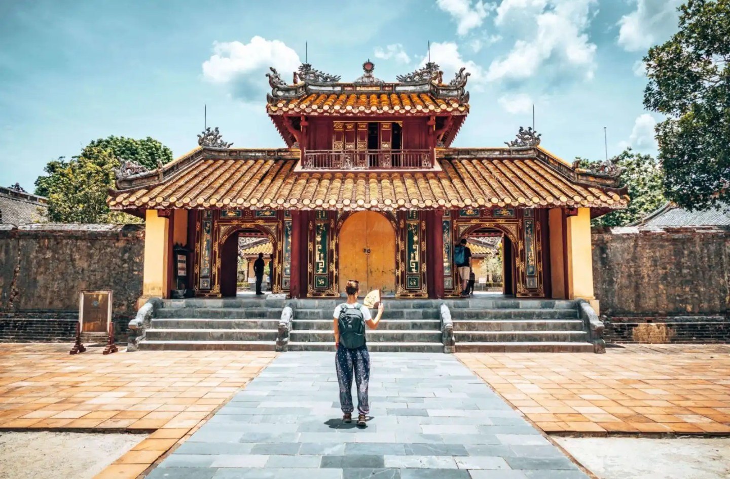 Picture of girl standing in front of Hue tomb
