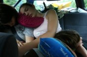 Our kids try to sleep off the long drive home.