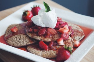 buckwheat pancakes with brandied strawberries & coconut whip