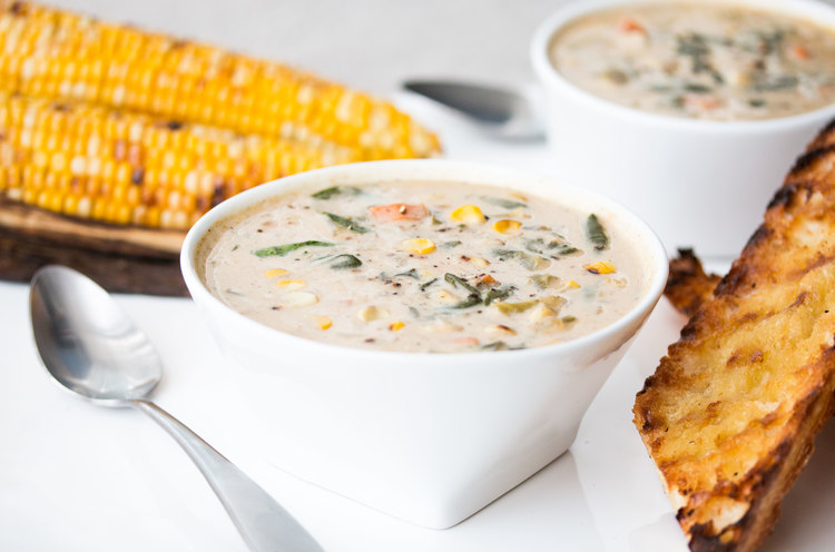 Image of bowl of vegan roasted corn chowder soup