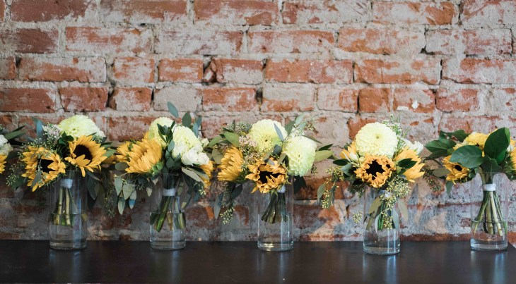 Image of bridesmaid bouquets with sunflowers for Colorado vegan wedding