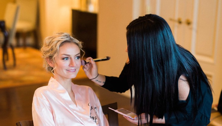 Bride getting bridal makeup done by vegan makeup artist Lauren Harvey