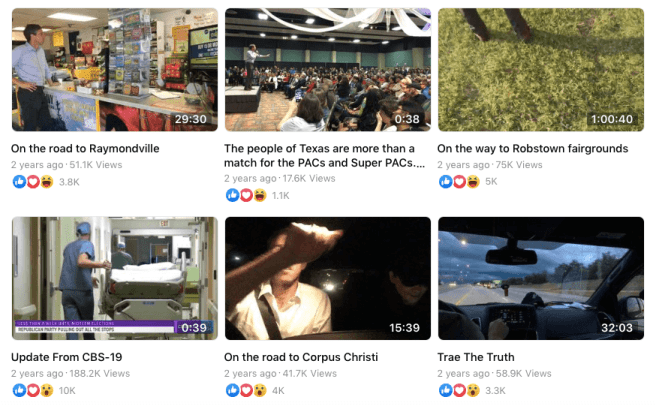 """Screenshot of Beto O'Rourke's Facebook video archives, with thumbnail photos previewing six different previously recorded videos. Captions on each video preview read, """"On the road to Raymondville,"""" """"The people of Texas are more than a match for the PACs and Super PACs..."""", """"On the way to Robstown fairgrounds,"""" """"Update from CBS-19,"""" """"On the road to Corpus Christi,"""" and """"Trae The Truth."""""""