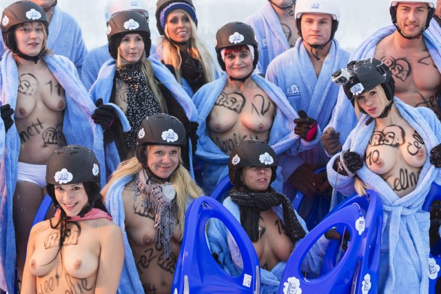 Competitors wearing only underwear and panties ride a sled in the 2013 naked snow-sledding competition on February 23, 2013 in Altenberg, Germany. The annual event, which this year drew thousands of spectators, is sponsored by a local radio station. (Joern Haufe / Getty Images)