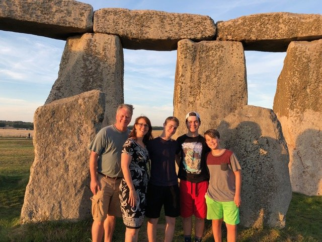 Our family of five posing among the rock formations inside the Stonehenge circle
