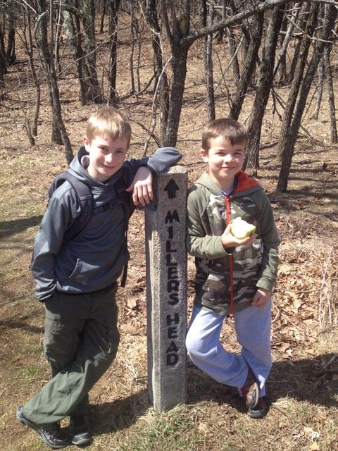 Two young boys posing with trail marker in Shenandoah National Park
