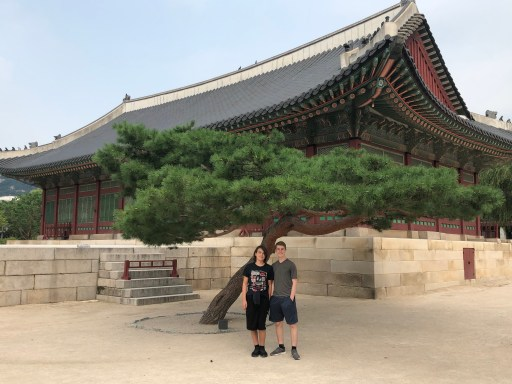 The Trip Takes Us crew poses in front of Sujeongjeon Hall, the king's sleeping quarters, at Gyeongbokung Palace in Seoul as part of the Seoul Airport Free Transit Tour.