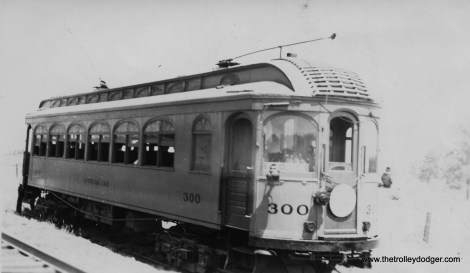 "CNS&M car 300 on a Central Electric Railfans' Association fantrip. For a few years, prior to WWII, the railroad let the fans use this as a ""club car."""