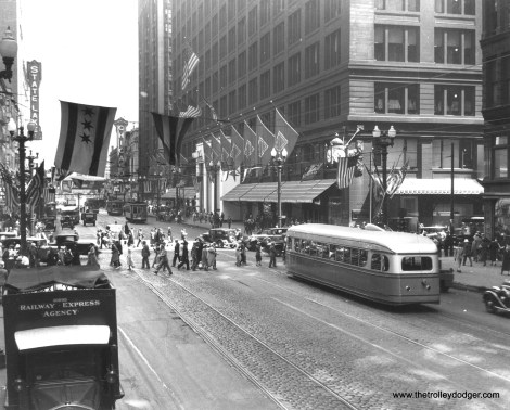 CSL 7001 northbound at State and Washington, 1934. This experimental pre-PCC car transported visitors back and forth to A Century of Progress. Note that there are only three stars on the Chicago flag. The fourth star, symbolizing Fort Dearborn, was added in 1939. (CSL Photo)
