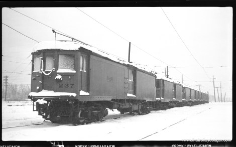 CNS&M 237 heads up six multiple unit express motors at Pettibone Yard, North Chicago Junction, February 13, 1960. (Richard H.