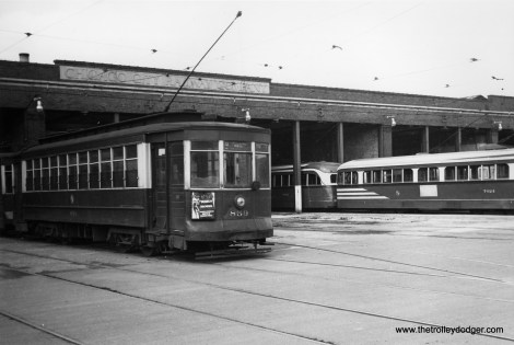 CTA red car 859 and prewar PCC 7024 are on hand at the 70th Street end of 69th Carhouse.