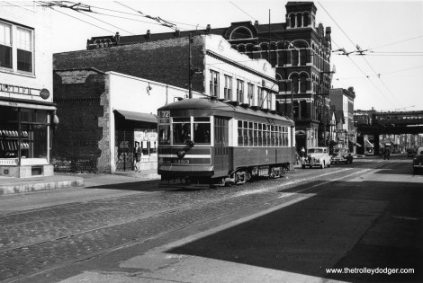 """CTA 3163 is westbound on route 72 - North Avenue in 1949, having just passed Halsted, on the first day of one-man operation. The """"L"""" at rear is now known as the Ravenswood Connector. (William C. Janssen Photo)"""