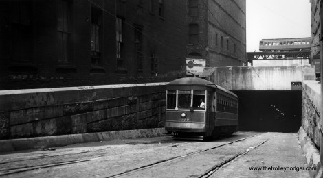 """Car 1677 is most likely being used for training in the Van Buren tunnel under the Chicago River in this scene. The Met """"L"""" is in the background. (Joe L. Diaz Photo)"""