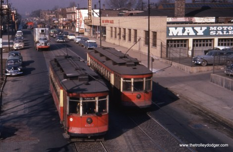 Red cars 652 and 678 pass on Halsted near 74th.