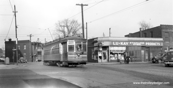 """CSL 3320 on the 67-69-71 route, """"crossing South Chicago Av on Anthony,"""" according to Andre Kristopans. On the other hand, Bob Lalich says, """"CSL 3320 is crossing South Chicago Ave on a very short street called Keefe Ave. which goes under the NYC/PRR elevation in a viaduct. Anthony runs parallel to the NYC/PRR elevation on the south."""""""