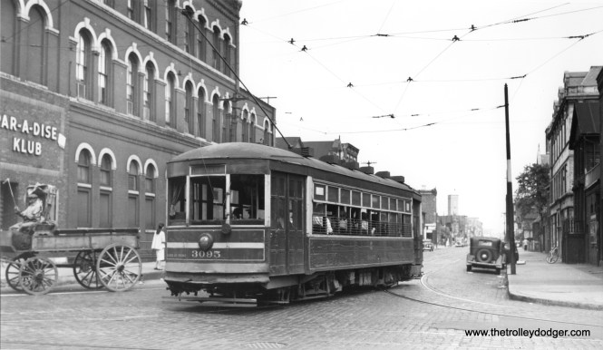 """CSL 3095 is """"NB turning off 21st onto Racine on Morgan-Racine-Sangamon route,"""" according to Andre Kristopans. Note the horse-drawn wagon near the Par-A-Dise Klub at left."""