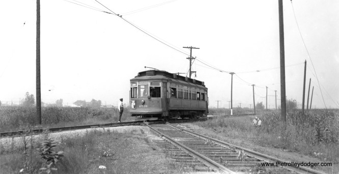 """CSL 2518 is southbound on the Brandon private right-of-way at the railroad crossing at 129th Street. Bob Lalich says, """"CSL 2518 is crossing the PRR Calumet River RR."""" (Joe L. Diaz Photo)"""