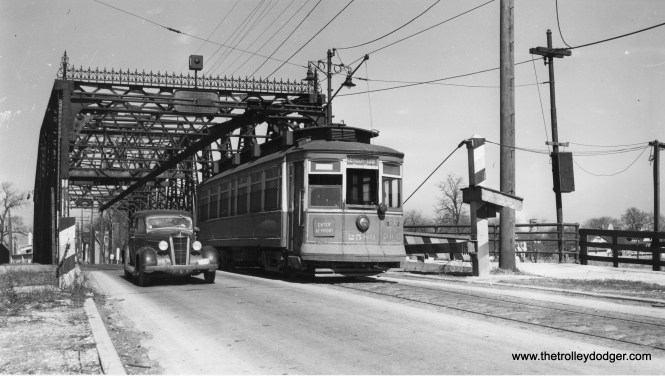 """CSL 2589 on Chicago's far south side. For some reason, """"Keep to right"""" is scrawled on the back of the car. Andre Kristopans says, """"2589 on Indiana crossing Calumet River at 132nd. This was a single track on what would be the NB lane, so the """"keep to right"""" would have been to warn drivers that passing a SB car on left might not be a good idea."""" (Joe L. Diaz Photo)"""