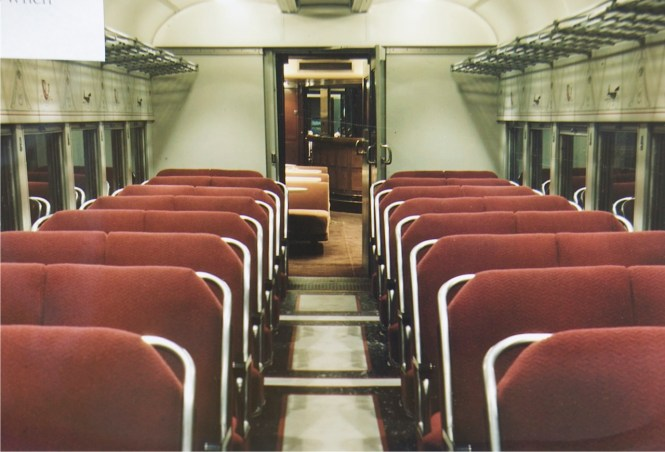 Here is a very early picture. Not sure who took the original - not me. The color of the fabric is redder than what we are finding under the seats as we reupholster. Of course, what we are finding is AT LEAST 52 years old, more like at least 60.