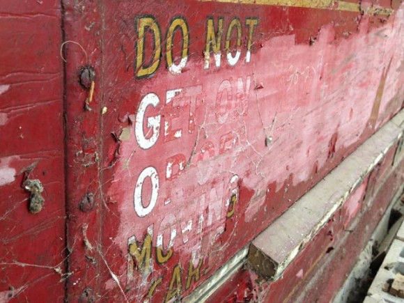 Not much of the original markings are seen on the trolley. Here, stencils rail experts date to the 1930s or 40s, warn riders to not get on or off moving cars. Credit: WLUK/Bill Miston