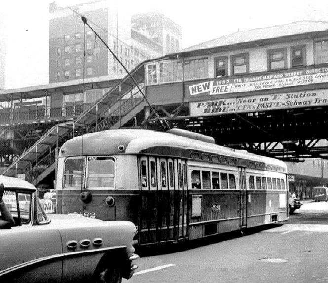 "A southbound 22, car 7182 waits at Lake and Clark. Notice the then ""new"" Buick Special (3 portholes, Buick lovers) taking part of the photo. © Laurence Mack"