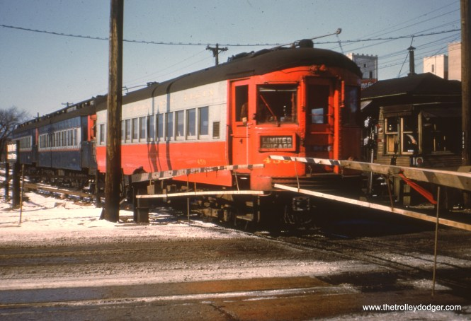 #23 - AK: EB train crossing Desplaines Av, note L staging track to left of main where L trains waited for leaving time. EM: CAE 459 (St. Louis, 1945) leads this three-car train heading for Chicago. View is looking Northwest.