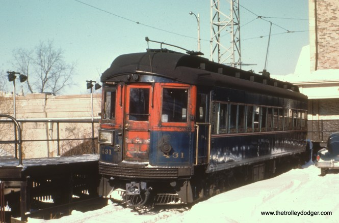 #63 - JN: Batavia terminal EM: This is a companion picture to picture 57. Same CAE 431 (Cincinnati 1927, now preserved at the IRM) and same automobile. The bridge over the Fox River is clearly visible.