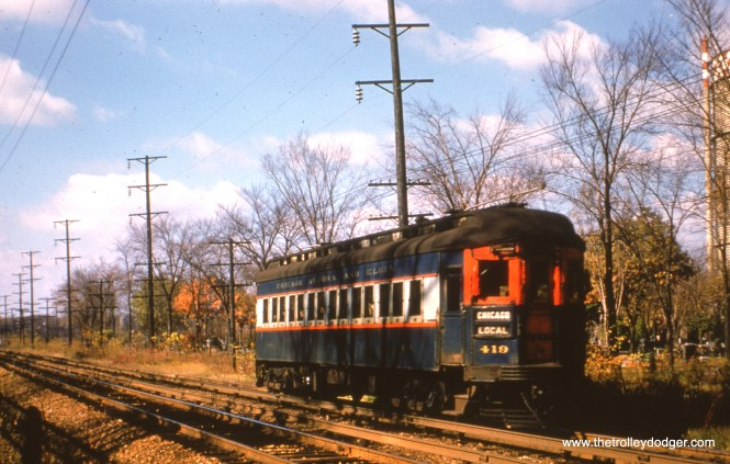 #78 - JN: Westbound car has just departed from Desplaines Ave. terminal. This section of track was moved north and rebuilt due to expressway construction. CA&E trains never operated on rebuilt track. EM: CAE 419 (Pullman, 1923) heads west towards 1st Av. Maywood having come from Des Plaines station. Looking NW.
