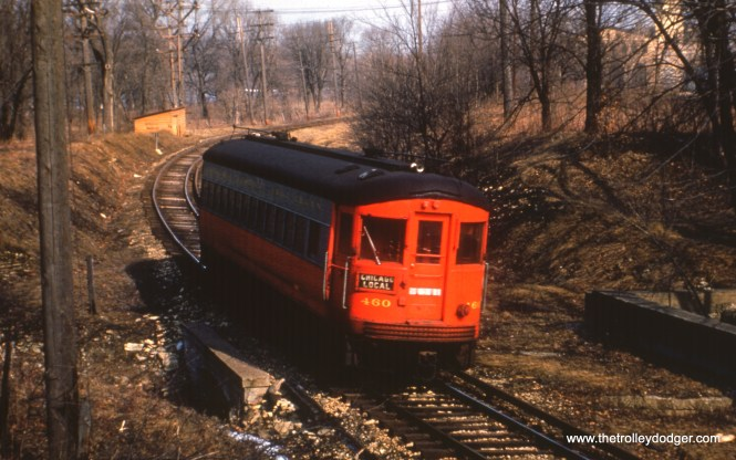 #92 - JN: Eastbound car crossing under CB&Q on Batavia branch. Old powerhouse can be seen on right through trees. EM: CAE 460 (St Louis, 1945) is on track curving away from the Fox River on the Batavia branch.