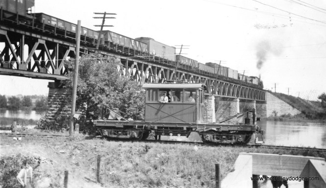 #4 - Aurora, Elgin & Fox River #49 at Coleman on September 1, 1940, with the Illinois Central overhead. This was one of the earlier CERA fantrips. By then, the line was freight-only, although still operating under wire. (Roy Bruce Photo)