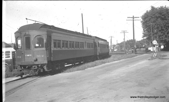 "#17 - CA&E 312 (described as ""part steel"") just west of Wheaton in August 1952 on the way to Aurora. This appears to be the same location (Childs Street) as Photo #88 in Part 2 of our recent CA&E Mystery Photos Contest. Randy Hicks: ""the lead car is the 309; the train is eastbound."""