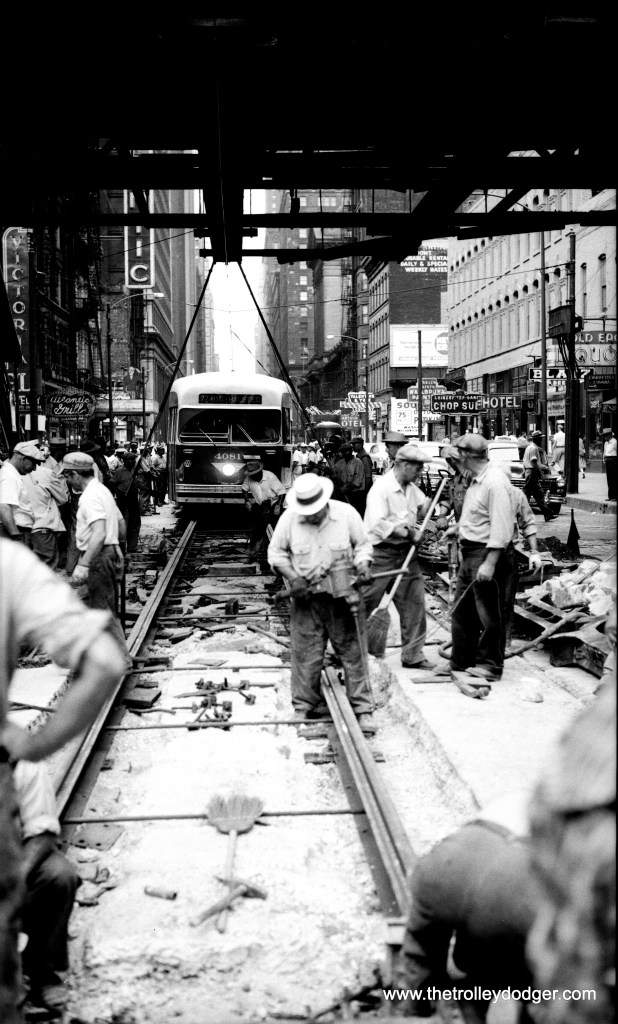 Here is another photo showing track work at Clark and Van Buren on July 17, 1954. We've added this to ten others we posted back in February. You can find that post at: http://thetrolleydodger.com/2015/02/12/track-work-clark-van-buren-1954/