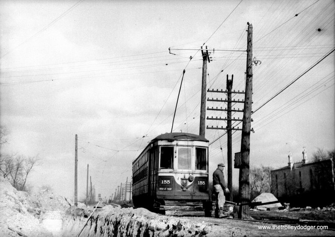 """C&WT 155 during winter. Bill Shapotkin says, """"I believe this photo is Hillgrove/LaGrange -- the short-lived terminal located east of LaGrange Rd after (sewer work(?)) cut the line back from Brainard Ave. View looks east."""""""