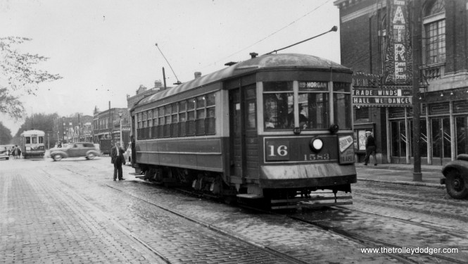 """CSL 1583 is parked in front of the old Park Theatre, which was located at 5962 W. Lake Street in Chicago's Austin neighborhood. Chicago & West Towns car 145 is in the background in Oak Park, on the other side of Austin Boulevard. The Park opened in 1913 and continued in operation until the 1950s. When this picture was taken, they were showing a double feature of Trade Winds and Shall We Dance, which came out in the late 1930s, but this picture seems to have been taken some years later from the looks of the autos. (Stephen D. Maguire Photo) Bill Shapotkin adds, """"Shows car #1583 working Through-route 16 (Lake-State - displaying the (according the Al Lind's CHICAGO SURFACE LINES (Pages 272-276)) rush-hour only operation 119th/Morgan)."""""""