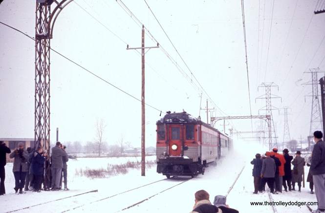 A snowy Skokie Valley Route photo run-by during a North Shore Line fantrip on February 21, 1960.