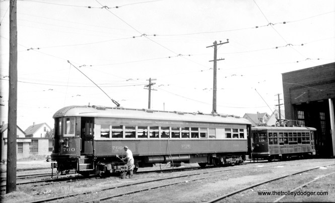 CNS&M 760 and a Birney streetcar at Harrison shops in Milwaukee. Looks like the 760 is being cleaned.