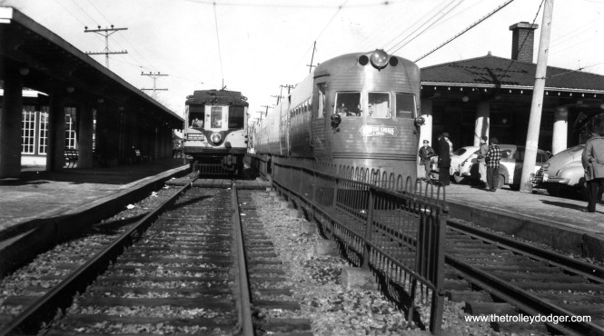 Milwaukee Electric car 1121 alongside an Electroliner (probably 803-804) at the Kenosha station. This was a 1949 fantrip where a TMER&T car was operated on part of the North Shore Line.